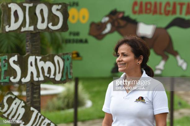 Honduran Maria Diaz executive of the Arca de Noe company smiles at the Joya Grande zoo and ecopark in Santa Cruz de Yojoa Cortes department 160 km...