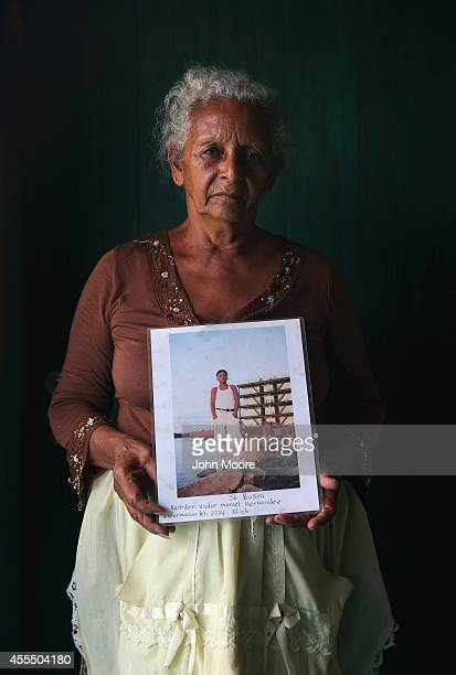 Honduran migrant Blanca Lydia Valenzuela holds a photo of her son Manuel Hernandez Valenzuela while at a shelter for undocumented immigrants on...