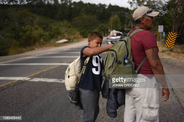 Honduran migrant Juan Hernandez and his son Marcos continue to head to the United States with a second caravan after the migrants reached an...