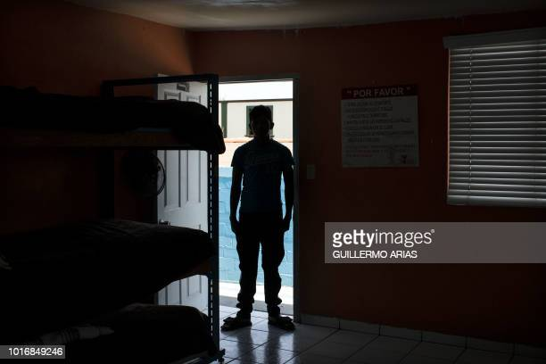Honduran migrant minor Javier is pictured in his room at 'Casas YMCA' migrant minors shelter in Tijuana Baja California state Mexico on August 10...