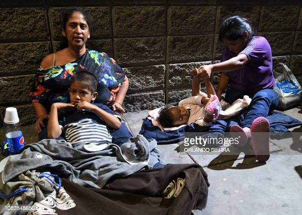 Honduran migrants gather at the Gran Central Metropolitana bus terminal while waiting for the second caravan to leave to the United States in San...