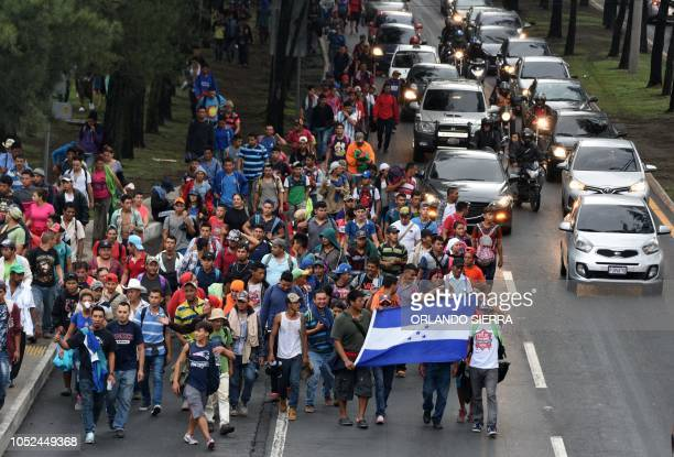 Honduran migrants heading in a caravan to the United States walk in direction to Tecun Uman the border with Mexico as they leave Guatemala City on...