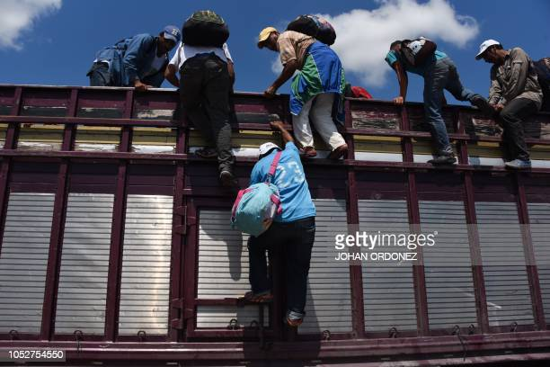 TOPSHOT Honduran migrants heading in a caravan to the US climb on a truck in Tapachula Chiapas state Mexico on October 22 2018 President Donald Trump...