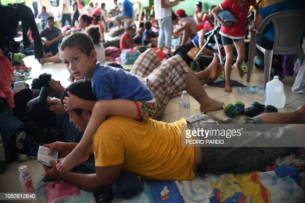 Honduran migrants heading in a caravan to the US rest at a temporary shelter in Ciudad Hidalgo Chiapas state Mexico on October 20 2018 Thousands of...