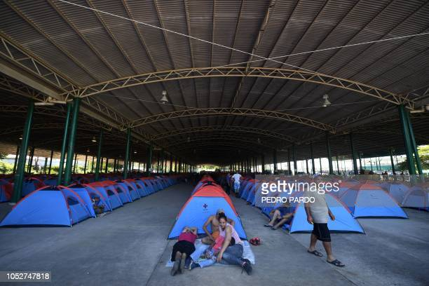 TOPSHOT Honduran migrants heading in a caravan to the US rest in tents at the International Mesoamerican Fair's venue in Tapachula Chiapas state...