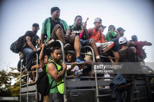 TOPSHOT Honduran migrants heading in a caravan to the US travel aboard a truck near Mapastepec Chiapas state Mexico on October 25 2018 Thousands of...
