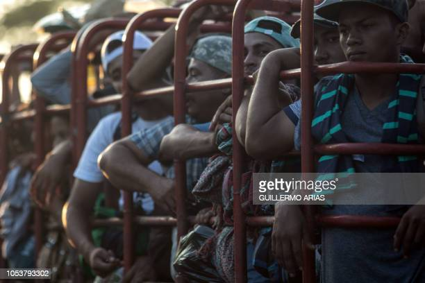 Honduran migrants heading in a caravan to the US travel on a truck near Pijijiapan southern Mexico on October 26 2018 The Pentagon is expected to...