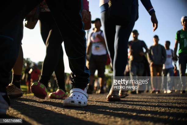 Honduran migrants heading in a caravan to the US walk in Metapa on their way to Tapachula Chiapas state Mexico on October 22 2018 President Donald...