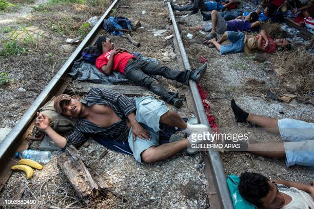 Honduran migrants heading in caravan to the US rest on the train tracks in Arriaga in southern Mexico on October 26 2018 The Pentagon is expected to...