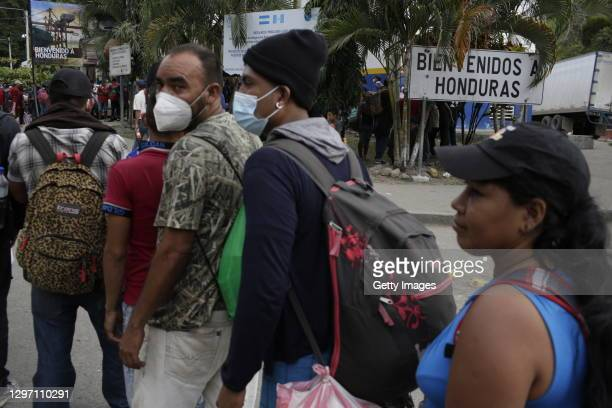 Honduran migrants line up for returning to their country on January 18, 2021 in El Florido, Guatemala. The caravan departed from Honduras to walk...