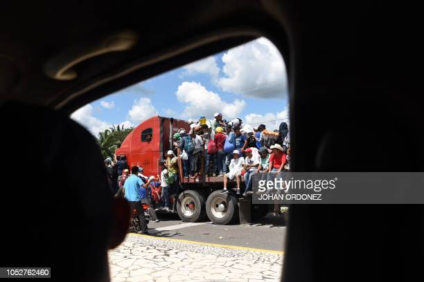 TOPSHOT Honduran migrants onboard a truck take part in a caravan heading to the US in the outskirts of Tapachula on their way to Huixtla Chiapas...
