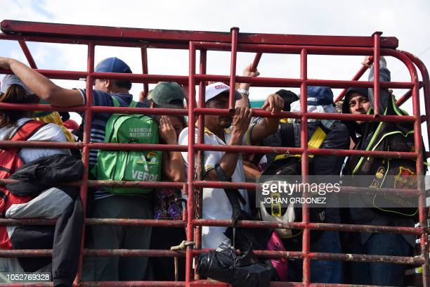 Honduran migrants onboard a truck take part in a caravan heading to the US near Huehuetan on their way from Tapachula to Huixtla Chiapas state Mexico...