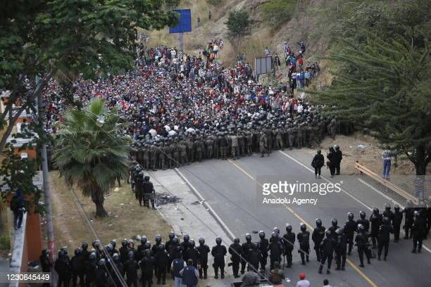 Honduran migrants, part of a caravan heading to the United States, remain in Vado Hondo, Guatemala on January 17, 2021. Guatemalan Army soldiers...