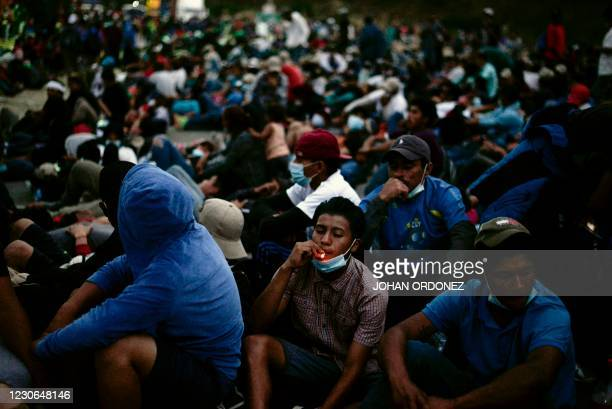 Honduran migrants, part of a caravan heading to the United States, take a rest in Vado Hondo, Guatemala on January 17, 2021. - Guatemalan police...