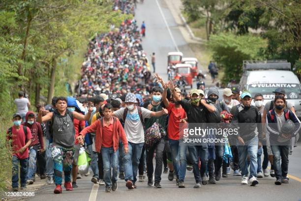 Honduran migrants, part of a caravan heading to the United States, walk along a road in Camotan, Guatemala on January 16, 2021. - At least 4,500...