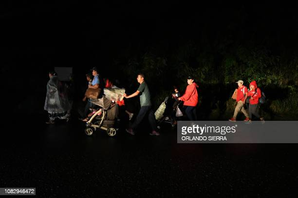 TOPSHOT Honduran migrants part of the second caravan to the United States leave San Pedro Sula 180 km north of Tegucigalpa on January 14 2019...