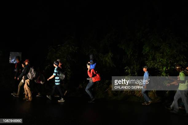 Honduran migrants part of the second caravan to the United States leave San Pedro Sula 180 km north of Tegucigalpa on January 14 2019 President...