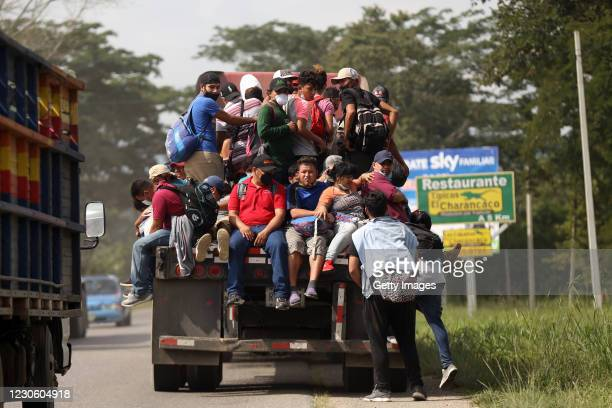Honduran migrants ride a truck to be trnsported to the Honduras-Guatemala border as part of their journey to the U.S. On January 15, 2021 in Nueva...