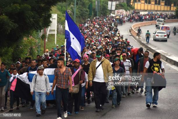 Honduran migrants take part in a caravan towards the United States in Chiquimula, Guatemala on October 17, 2018. - A migrant caravan set out on...