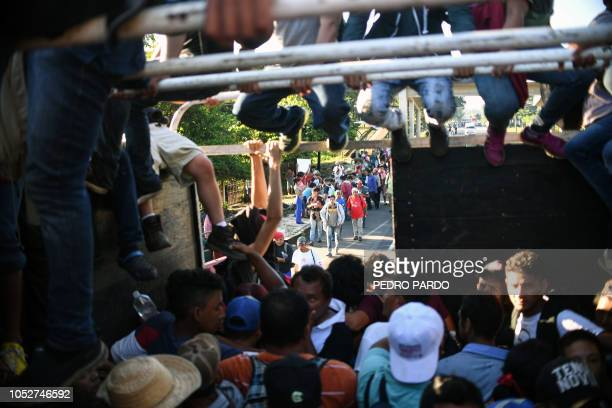 TOPSHOT Honduran migrants taking part in a caravan heading to the US aboard a truck in Metapa on their way to Tapachula Chiapas state Mexico on...