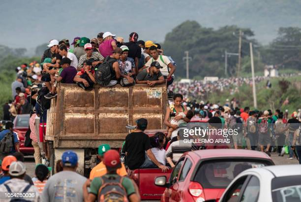 TOPSHOT Honduran migrants taking part in a caravan heading to the US leave Arriaga on their way to San Pedro Tapanatepec southern Mexico on October...