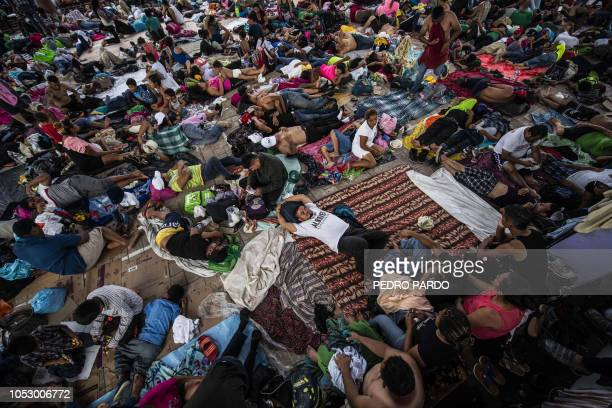 Honduran migrants taking part in a caravan heading to the US rest during a stop in Mapastepec Chiapas state Mexico on October 24 2018 Thousands of...