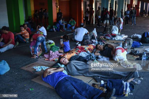 Honduran migrants taking part in a caravan heading to the US rest at the main square in Tapachula Chiapas state Mexico on October 22 2018 President...