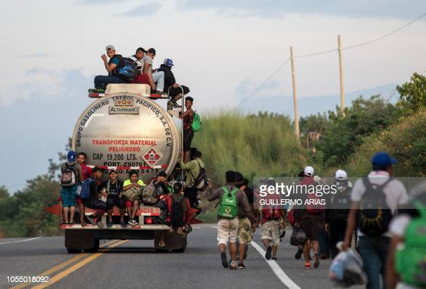 Honduran migrants taking part in a caravan heading to the US resume their march from San Pedro Tapanatepec to Santiago Niltepec Oaxaca State Mexico...