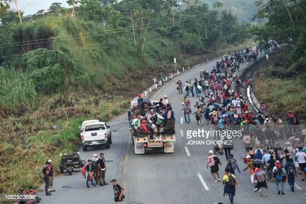 Honduran migrants taking part in a caravan heading to the US walk alongside the road in Huixtla Chiapas state Mexico on October 24 2018 Thousands of...