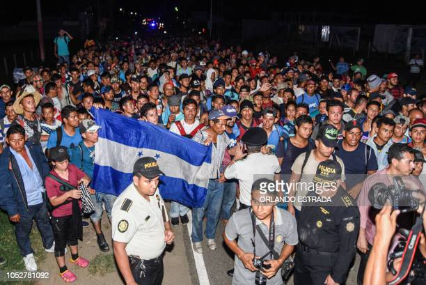 TOPSHOT Honduran migrants taking part in a new caravan heading to the US arrive to Chiquimula Guatemala on October 22 2018 US President Donald Trump...