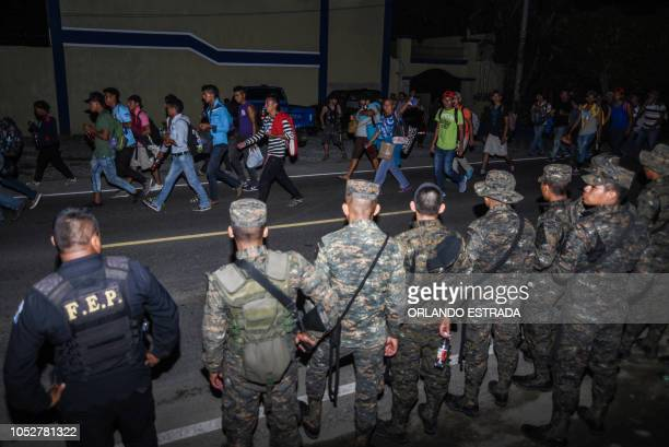 Honduran migrants taking part in a new caravan heading to the US arrive to Chiquimula Guatemala on October 22 2018 US President Donald Trump on...