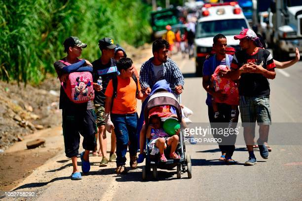 Honduran migrants they take part in a caravan heading to the US in the outskirts of Tapachula on their way to Huixtla Chiapas state Mexico on October...