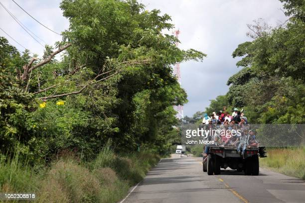 Honduran migrants travel in a caravan north on October 16 2018 near Quezaltepeque Guatemala The caravan of more than 1500 people the second of its...
