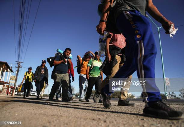 Honduran migrants who are part of the 'migrant caravan' walk towards Tijuana on November 26 2018 in Mexicali Mexico Around 6000 migrants from Central...