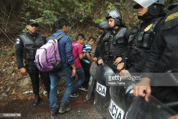 Honduran migrants who were not part of a new 'migrant caravan' and have jobs in Guatemala are allowed to cross as police block a roadway to a border...