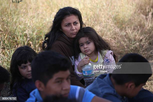 Honduran mother holds her daughter after she turned her family in to US Border Patrol agents on December 8 2015 near Rio Grande City Texas They had...