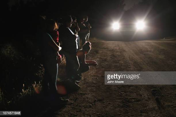 Honduran mother holds her two-year-old as U.S. Border Patrol agents arrive to take them and other migrants into custody at the U.S.-Mexico border on...
