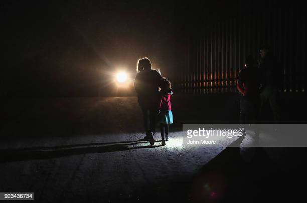 Honduran mother walks with her children next to the USMexico border fence as they turned themselves in to Border Patrol agents on February 22 2018...