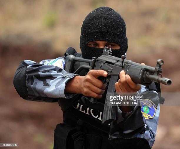 Honduran police 'Cobra' commandos show their skills during an exhibition held in Tegucigalpa on April 3 2008 AFP PHOTO/Orlando SIERRA