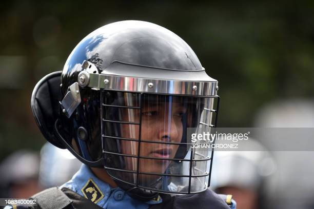 A Honduran police officer stands by as migrants heading to the United States with a second caravan wait in Agua Caliente Chiquimula region Guatemala...
