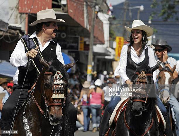 Honduran president Jose Manuel Zelaya talks with his daughter Xiomara January 17 during a horse rally that was dedicated to him in the town of...