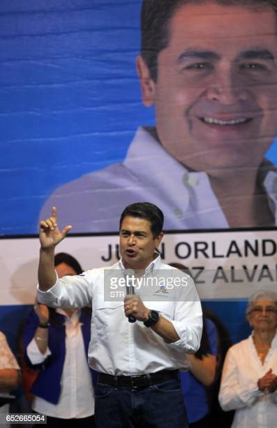 Honduran President Juan Orlando Hernandez addresses supporters following victory in the primary elections of the National Party in Tegucigalpa March...