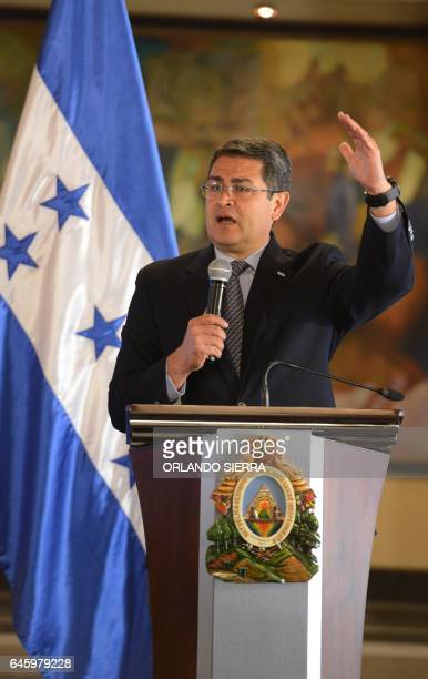 Honduran President Juan Orlando Hernandez delivers a speech about his new decree on security issues in Tegucigalpa on February 27 2017 The new law...