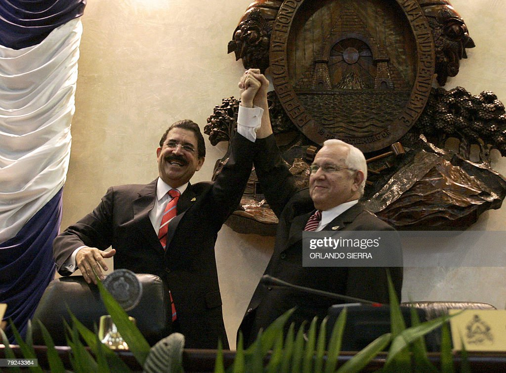 Honduran president, Manuel Zelaya (L), and president of Congress, Roberto Micheletti (R), celebrate the instalation of the third legislature in Tegucigalpa, 25 January, 2008. Zelaya, who has so far served two of his four years in office, had strong discrepancies with Micheletti recently, after calling him a 'liar' in response to the confirmation of electoral reforms in Congress. AFP PHOTO/Orlando SIERRA.
