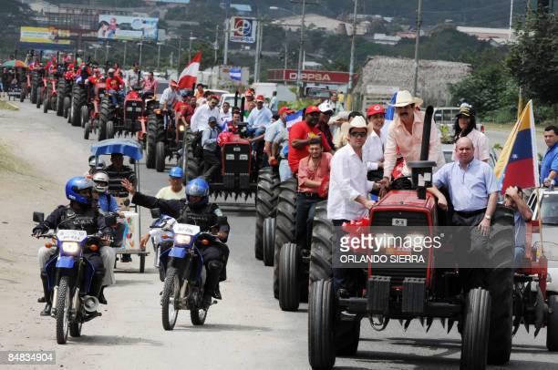 Honduran President Manuel Zelaya his son and San Pedro Sula's Mayor Rodolfo Padilla head a convoy of tractors during the handing over of 100 tractors...
