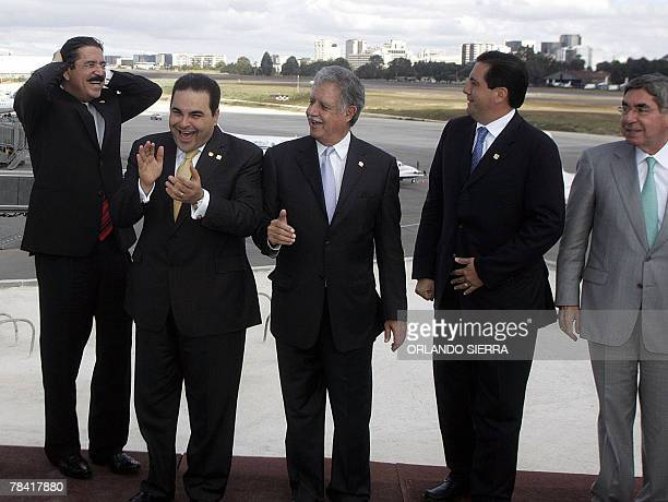 Honduran president Manuel Zelaya jokes with his counterparts from El Salvador Antonio Saca Guatemala Oscar Berger Panama Martin Torrijos and Costa...