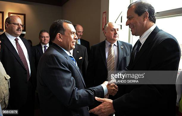 Honduran President Porfirio Lobo shakes hands with Gonzalo Marroquin vice president of the Inter American Press Association after signing the...