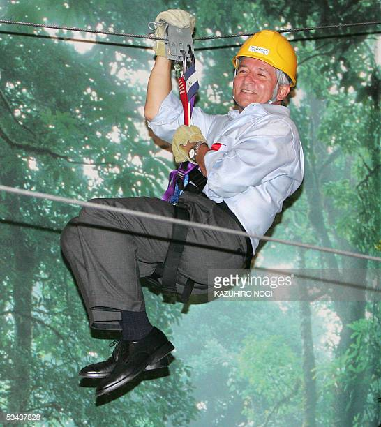 Honduran President Ricardo Maduro tries a pulley on a wire at an athletics event 'Canopy Tour' at the Central America pavilion in the 2005 World Expo...