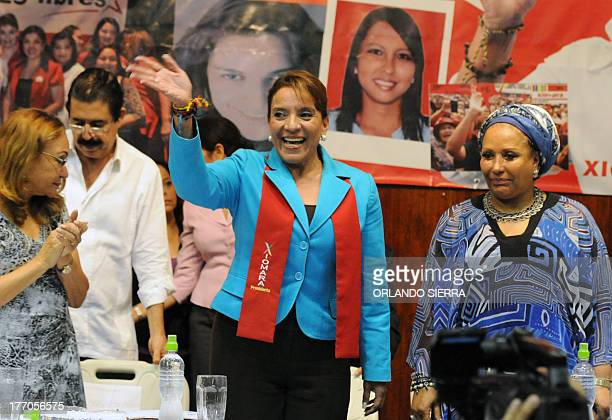 Honduran presidential candidate for the Liberty and ReFoundation Party party Xiomara Castro waves next to Colombian former senator Piedad Cordoba and...