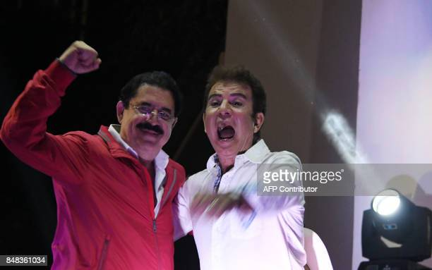 Honduran presidential candidate for the Opposition Alliance party Salvador Nasralla and former president Manuel Zelaya cheer at supporters during a...